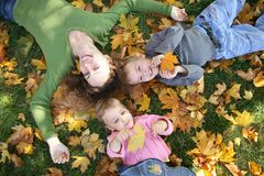 Mom with children on grass Stock Image