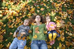 Mom with children on grass2 Royalty Free Stock Photography