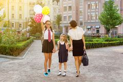 Mom and children holding hands, go to school. Mother and children holding hands, go to school Royalty Free Stock Photos