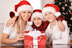 Mom and children in santa hats Stock Image