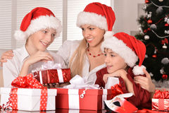 Mom and children in santa hats Royalty Free Stock Image