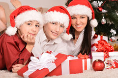 Mom and children in santa hats Royalty Free Stock Images