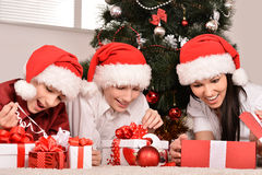 Mom and children in santa hats Stock Photography