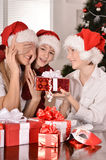 Mom and children in santa hats Royalty Free Stock Photo