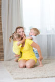Mom and children twins  playing Royalty Free Stock Image