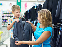 Mom chooses suit for little son Stock Photo