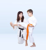 Mom the coach teaches son is beat kick leg Stock Images
