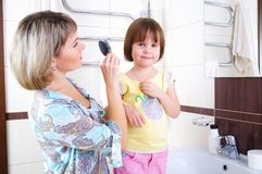 Mom combing hair Royalty Free Stock Image