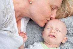 Mom Comforting Crying Baby Royalty Free Stock Photos