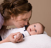 Mom communicates with baby. Mom communicates with her baby Royalty Free Stock Images