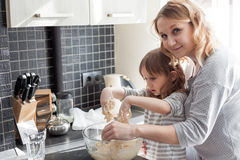 Mom cooking with daughter Royalty Free Stock Photos