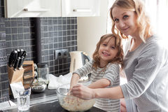 Mom cooking with daughter Royalty Free Stock Images