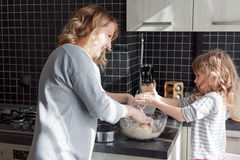 Mom cooking with daughter Royalty Free Stock Photo