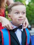 Mom corrects bow-tie son Royalty Free Stock Photo