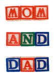 Mom And Dad. The words mom and dad, spelled out using baby letter blocks, isolated against a white background Stock Photography