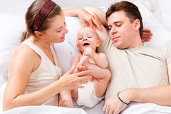 Mom, dad and baby Stock Photos