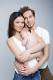 Mom dad and baby. Loving parents with their cute little son stock images