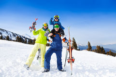 Mom, dad with child on his shoulders in ski masks Royalty Free Stock Photography