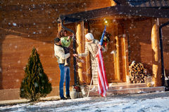 Mom, dad and daughter decorate the Christmas home Stock Images