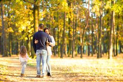 Mom and dad with daughter at sunset playing stock photography
