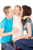 Mom and Dad give a kiss Stock Photography