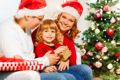 Mom and dad give New year presents to little girl Royalty Free Stock Photo