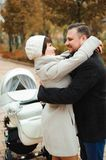 Mom and Dad hugging in the autumn park royalty free stock images