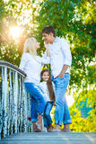 Mom, Dad and kid laughing hugging, enjoying nature Royalty Free Stock Photography