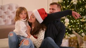 Mom, Dad And Little Baby Daughter . Loving Family Merry Christmas and Happy New Year. Cheerful Pretty People. Parents stock video