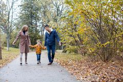 Mom dad and a little boy walk in the Park. 1 stock photos