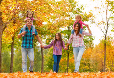 Mom dad and little girls walk in forest together Royalty Free Stock Photos
