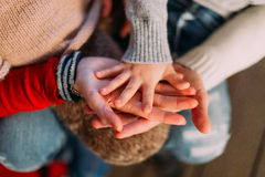 Mom, dad and little son holding hands close up Royalty Free Stock Photo