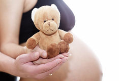 Mom and dad prepare bear doll for a new life. Family complete royalty free stock photos