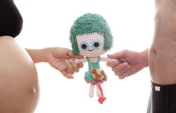 Mom and dad prepare girl doll for a new life royalty free stock photos