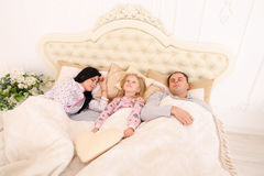 Mom, Dad sleep, and my daughter can not wake them up or go aslee Royalty Free Stock Photo