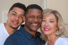 Mom and dad smiling with their son. Royalty Free Stock Images