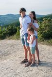 Mom dad and son don`t want to be photographed on the mountain with seascape. Family photo. Mom dad and son don`t want to be photographed on the mountain with Royalty Free Stock Photo