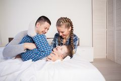 Mom dad and son lie on the bed at home dream. Mom dad and son lie on the bed at home woke up Royalty Free Stock Photography