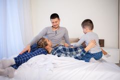 Mom dad son in the morning in bed. 1 royalty free stock images