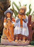 Mom dad and son with Peruvian clothes that symbolize the Holy Fa. Mily of the Christmas nativity scene made of painted terracotta stock photo