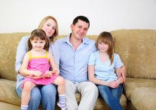 Mom, Dad and their two daughters Royalty Free Stock Photos