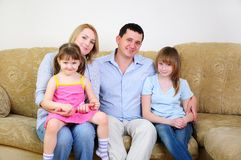 Mom, Dad and their two daughters Stock Photos