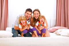 Mom dad and twins daughters having fun time Stock Images