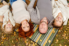 Mom, dad and two charming sisters in the same curly beige knit s stock photography