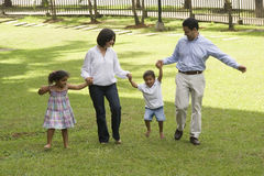Mom and dad walking with their children Royalty Free Stock Photo