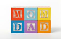 Mom and dad words written with play blocks. Combination of mom and dad words with play blocks Stock Photo