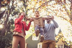 Mom and daddy make me to fly. On the move. Royalty Free Stock Photos