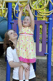 Mom and Daughter. A mom playing at the park with her daughter royalty free stock images