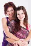 Mom daughter. Middle aged mom and teen daughter portrait in studio Stock Images