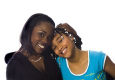 Mom & daughter. African American Mother and daughter sitting in a cosy chair smiling on a white background Stock Images